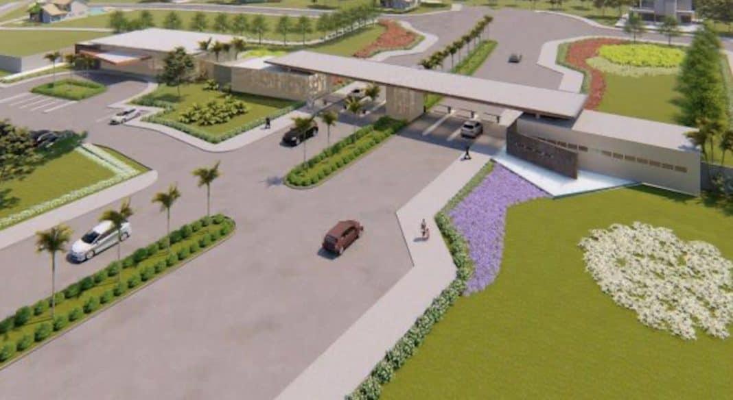 Imagem aérea de projeto de bairro planejado, com portaria central com entrada e saída de veículos