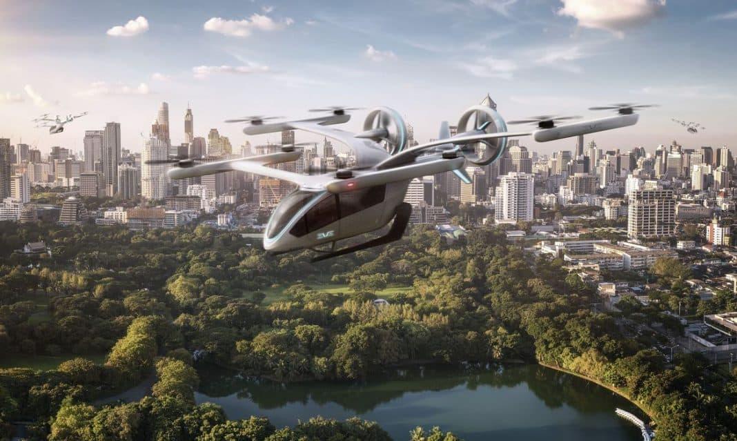 Fotografiade protótipo de carro voador elétrico da embraer sobrevoando cidade