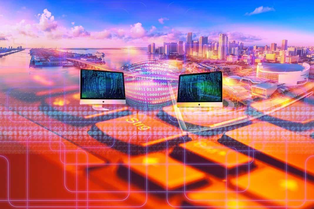 Reprodução de imagem de cidade que remete às funcionalidades de governo digital e/ou eletrônico, exemplificando a conectividade e tecnologia de uma smart city, por meio de ferramentas digitais. Imagem multicolorida e com predominância do laranja e azul