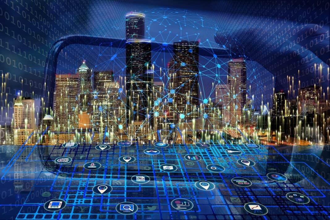 Reprodução de imagem/ilustração de cidade inteligente, com várias conexões de tecnologias interligadas à tela de um celular em referência a cidade